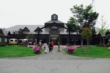 Pretty flowers and a gorgeous lawn await you at the winery