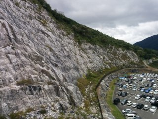 The amazing cliff bordering the parking lot is just a warm-up