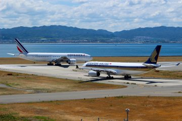 2 planes on the runway at Kansai Airport. Your journey in Japan might begin here.