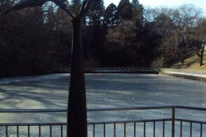 Japan's first ice skating rink.A piece of art hints at the story of the pond.
