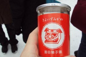 Local saké  is sold at the food stalls. Strong drinks help you forget how cold it is.