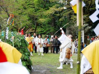 All actions and implements of a fire ceremony have symbolic meaning. Here is a yamabushi shooting off arrows in 6 directions to drive away evil spirits