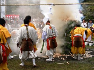Once the bonfire is lit, yamabushi throw goma ki, wooden sticks containing peoples' wishes, into the fire