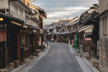 A quiet street lined with old buildings