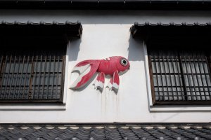 Red goldfish are the trademark of this city
