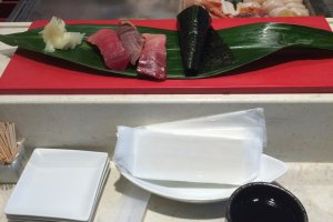 Try the stand-up sushi bar in Haneda Airport.