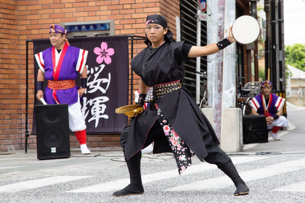 Eisa youth member performing in Kokusai Dori during summer