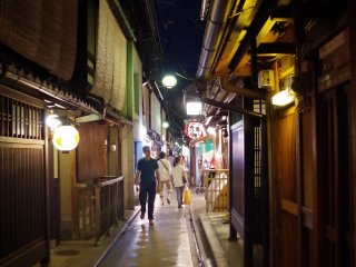 The narrow street is filled with old Japanese houses