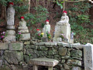 Buddhist statues on the side of the path