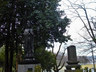 A large graveyard is situated along the hillside to the east of the monastery