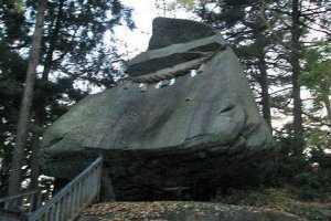 Follow a path along the shrine and find a huge boulder shaped like a samurai helmet.