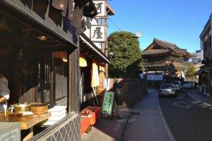 Chefs preparing meals on Narita Omotesando