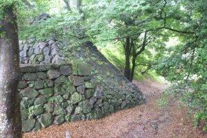 The steep walls and moats surrounding Yoshida Castle