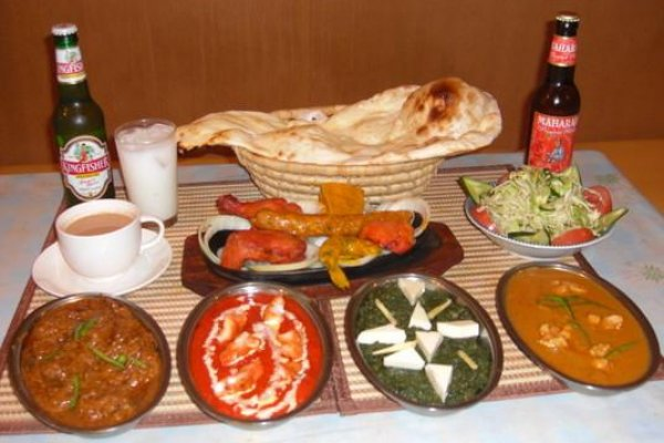 A banquet fit for a maharajah or sumo wrester with curries chicken and naan at Asian Sitaare in Kintetsu Fuse in Osaka