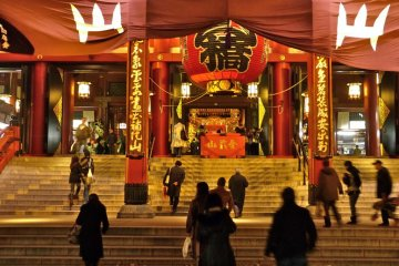 Many people visit the temple, even at night
