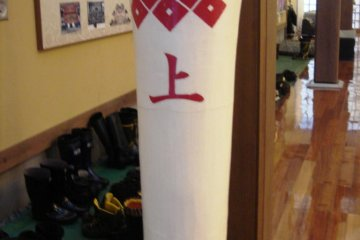 "Large candle symbolising the ""kami"" group of Kurokawa's Noh guilds"