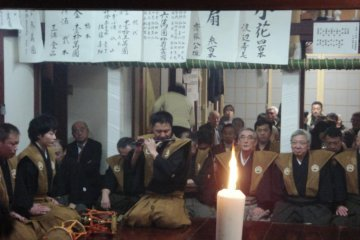 The flute player is an essential member of the group of instrumentalists in any Noh performance