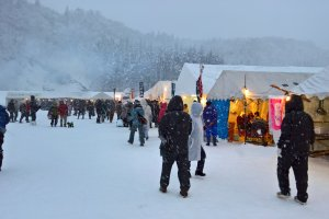 Some tents are set up to eat and stay warm before the start of the festival