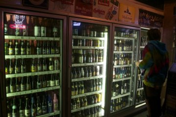 A customer browses the selection of bottles.