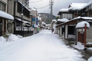 The main street of Yutagawa Onsen in winter