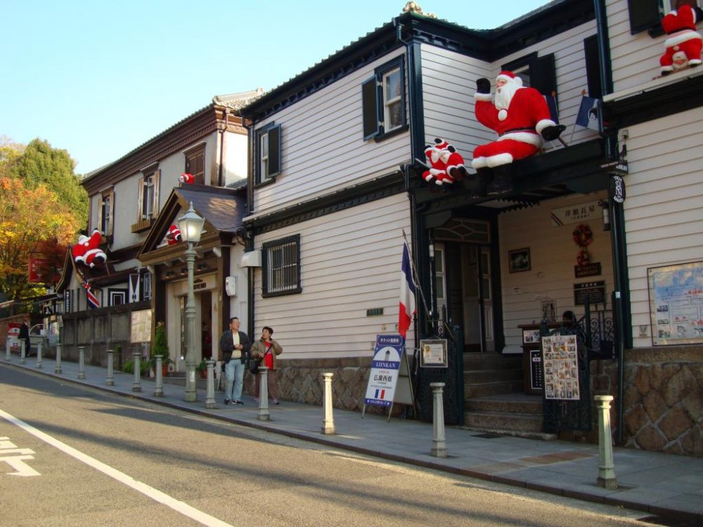 Santa Claus on rooftops in the historical district of Kitano Ijinkan