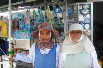 These old ladies have been working their whole life at Aharen Beach Tokashiki-son Island Okinawa
