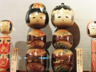 Artistic kokeshi with different designs of shape and decor
