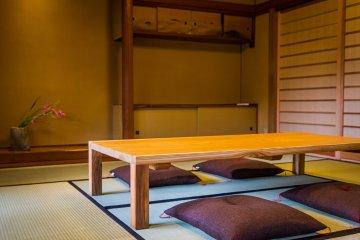 Sit on zabuton in the tatami room