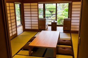 The tatami room looks through the engawa to the garden