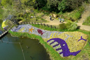 You can see the park's flower art from the bridge