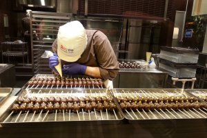 Each chocolate is given its finishing touches by hand