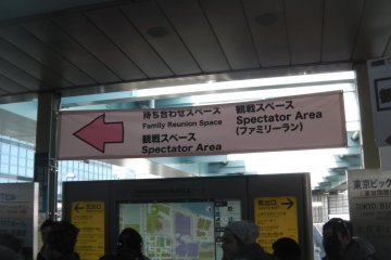 Signs at the train station point the way