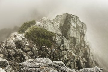 Despite the heavy mist and thick fog however, many of these mountains rocky features are still very prominent