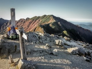 Reaching the summit of Kumasawa-dake
