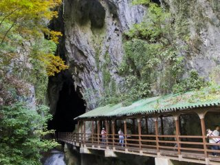 The magnificent waterfall portal with magical covered bridge