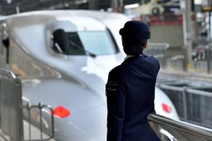 Staff farewelling the bullet train going to Tokyo