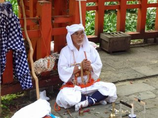 You may meet some white-clad pilgrims praying at the shrines on Haguro-san.