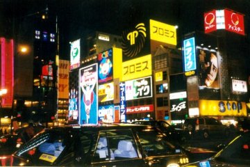<p>The magic of the night is reflected in the shiny taxicabs on Midosuji dori next to Osaka&#39;s heartbeat Dotonbori which is sandwiched between Nanba and Shinsaibashi</p>