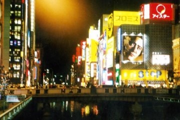<p>The neon lights are reflected on the river at Osaka&#39;s heartbeat Dotonbori. During the World Cup, fans would jump into the river to celebrate when their team won. See Japan at play in this unihibited place of fun.</p>
