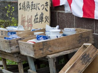 Crates full of ceramics lie on the roadside in the pottery town of Arita
