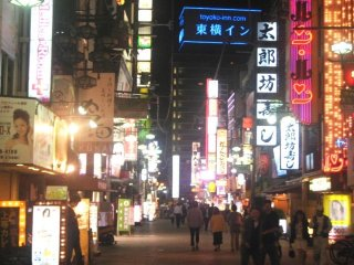 The streets are lit up with Neon signs at Juso the crossroads between Umeda, Osaka Itami Airport, Kyoto and Kobe