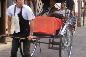 """rickshaw and driver wearing """"happi"""""""
