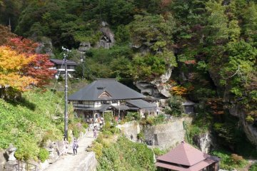 Autumn foliage, caves, paths and buildings of Yamadera Temple