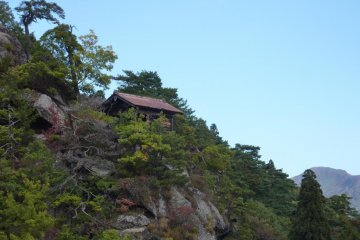 Photo from Yamadera Temple over the side of the mountain with a temple building on the edge of a cliff