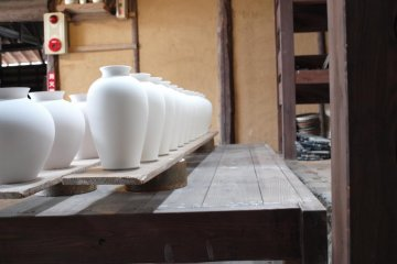 <p>Vases ready to be baked in the oven at the Kakiemon pottery</p>