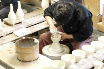<p>A potter at work, shaping the vase</p>