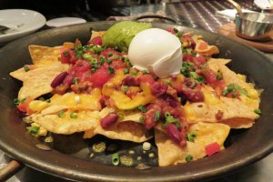 Crowd pleasing nachos with the freshest cream and avocado