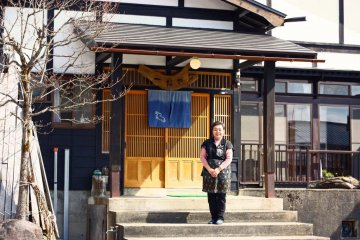 <p>Eiko-san stands outside the restaurant, which is built in the traditional Kaneyama style.</p>