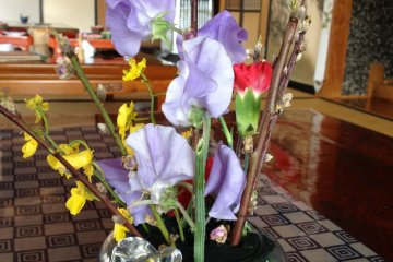 <p>Spring flowers add a splash of colour to the table.</p>
