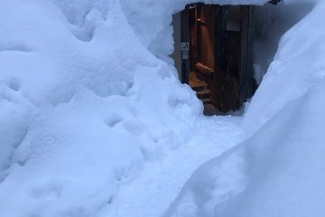 An entrance buried in snow